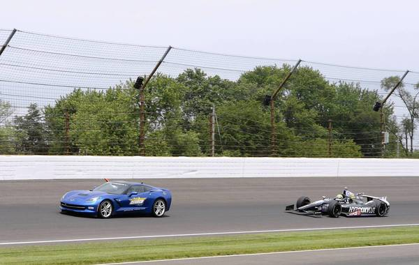 Tony Kanaan follows the pace car under a yellow flag en route to winning the Indianapolis 500 on Sunday.
