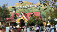 Police were evacuating people Tuesday evening at Disneyland's Toontown after a report of an explosion that appeared to have involved dry ice, authorities said.