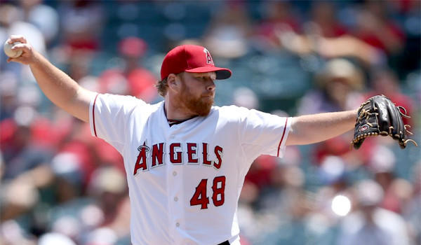 Angels pitcher Tommy Hansen returned to the Angels' clubhouse Tuesday after taking time off to grieve for the passing of his younger brother.