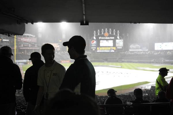 Fans wait out the rain delay.