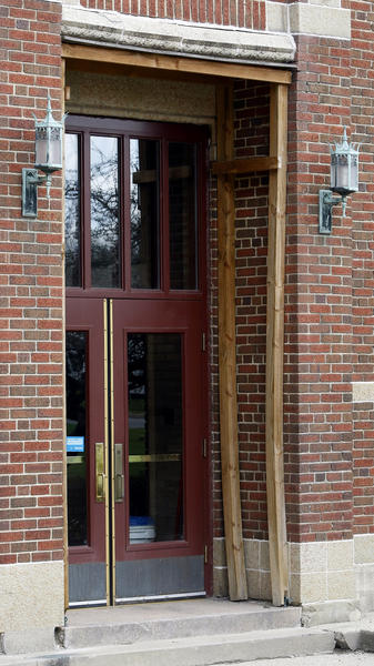 Wood beams and frames support the masonry work surrounding the entrances to the east gymnasium at Mishawaka High School.