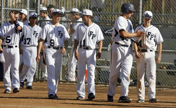 Flintridge Prep baseball players walk onto the field after losing a CIF Southern Section Division VI semifinal playoff game against Desert Christian Academy, 12-4, at the Glendale Sports Complex. (Cheryl A. Guerrero/Staff photographer)