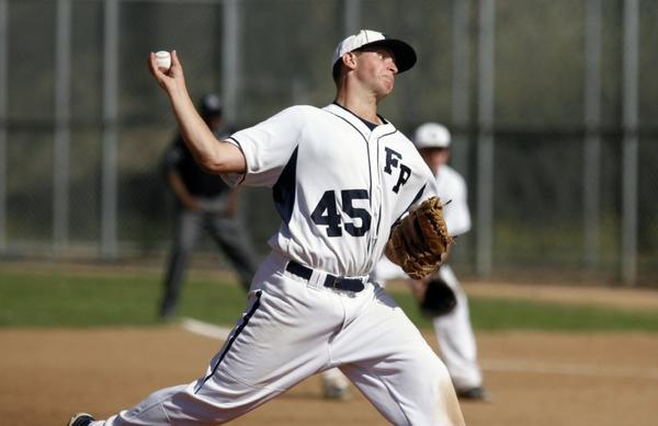 Flintridge Prep's Karlsen Termini pitches during semifinal playoff action against Desert Christian Academy at the Glendale Sports Complex. The Rebels' season ended after a 12-4 loss. (Cheryl A. Guerrero/Staff photographer)