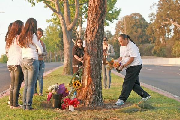 Visitors pay their respects at the site where five teens where killed.