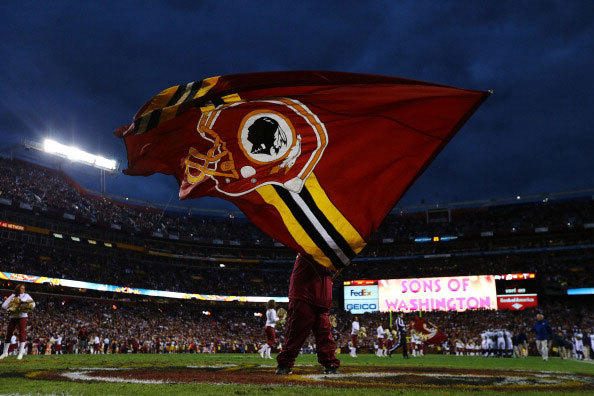 A Washington Redskins flag is waved prior to the NFC Wild Card Playoff Game against the Seattle Seahawks at FedExField on January 6, 2013 in Landover, Maryland.