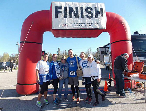 Courtesy Photo.Digital editor Zac Britton (center) was joined by former high school classmates for the Mackinac Memorial Bridge Run on Saturday  a key event during a holiday weekend visit for the downstate residents.