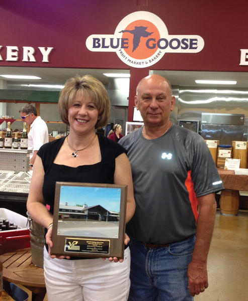 Randy and Penny Pittman of Hancock, owners of Blue Goose Bakery and Fruit Market in Hancock, display the award announcing that the construction of their business earned Myers Building Systems of Clear Spring membership in Varco Pruden Buildings' 2013 Hall of Fame.