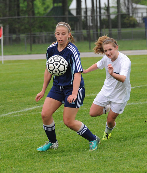 Petoskeys Shelby Laser (left) settles a ball in front of Gaylords Brandi Wagner during Tuesdays Division II district match in Gaylord. The Blue Devils defeated the Northmen in double overtime, 2-1.