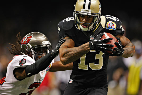 New Orleans Saints wide receiver Joe Morgan (13) races past Tampa Bay Buccaneers cornerback E.J. Biggers (31), as he goes 34 yards for a touchdown during a 2012 game.