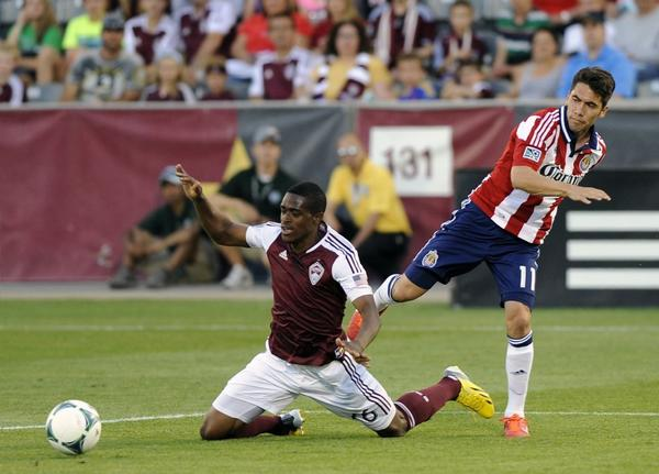 Colorado Rapids forward Deshorn Brown, left, collides with Chivas USA forward Gabriel Farfan during a game on Saturday.