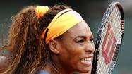 Williams of the U.S. reacts during her women's singles match against Garcia of France at the French Open tennis tournament in Paris