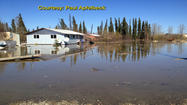 Floodwaters in Galena forced more residents from their homes as evacuations continued Wednesday. State emergency officials say more than 300 people have been evacuated out of Galena, or left on their own after Yukon River flooding hit the community hard.