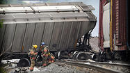 Rosedale train derailment creates explosion that broke windows; smoke visible for miles