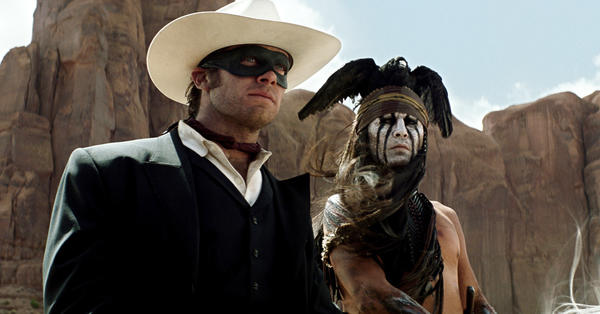 "Armie Hammer, left, stars as the titular hero and Johnny Depp as Tonto in ""The Lone Ranger."""