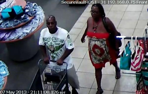 Surveillance photo of a couple suspected of stealing 19 pairs of shoes from the Burlington Coat Factory in Coral Springs