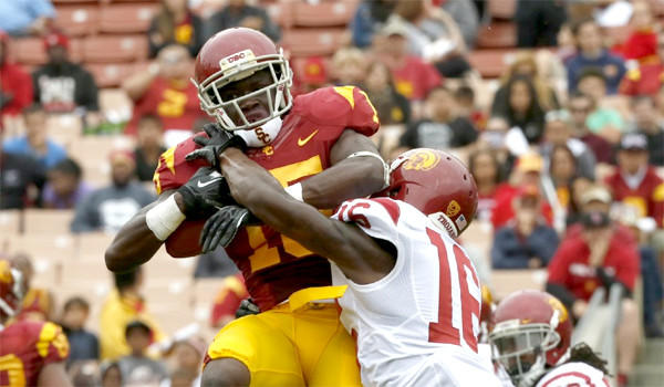 Wide receiver Nelson Angolor makes a catch at the end of USC's spring scrimmage at Los Angeles Coliseum on April 13, 2013.