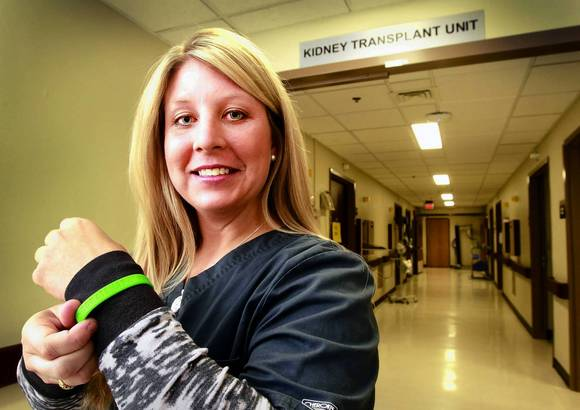 Aimee Bultemeier of Lee's Summit, a nursing assistant at the Mid America Heart Institute, not only wears a Donate Life bracelet, but already has donated one of her kidneys to someone she never met.