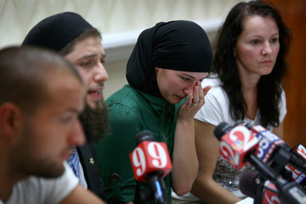 Khusen Taramov, a friend of Ibragim Todashev, front left, CAIR-Tampa Executive Director Hassan Shibly, Todashev's widow Reniya Manukyan, and Todashev's mother-in-law Elena Teyer, speak at a press conference on May 29, 2013 regarding Todashev's death.