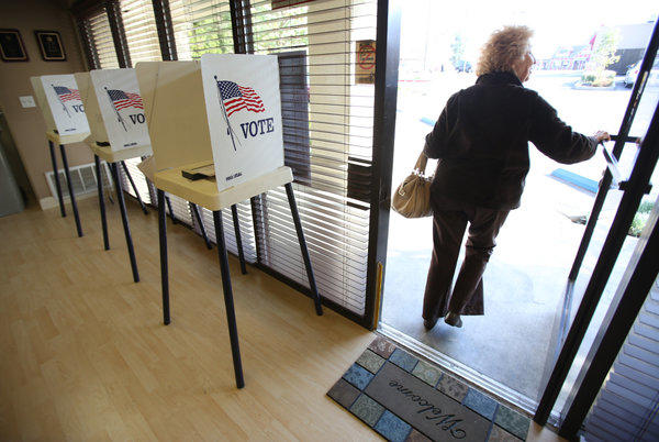 Lyn Levine, 80, leaves her polling place at Encino Self Storage on Ventura Boulevard after voting in the March election. Bills passed by the Senate would require greater disclosure of campaign finances in California's elections.