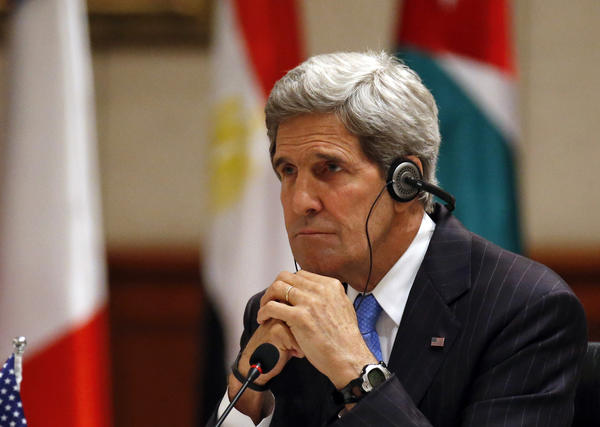 Secretary of State John Kerry listens about Syria at a meeting of the London 11 in Amman, Jordan.
