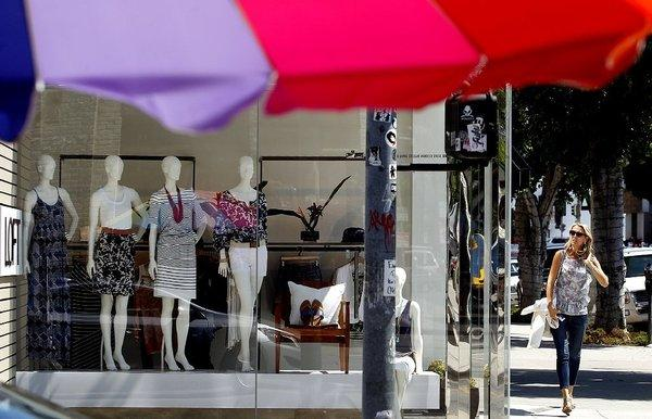 Jelena Trifunovic, right, passes by a store on Robertson Boulevard in Los Angeles.