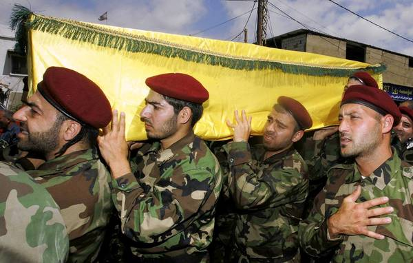 Supporters of Hezbollah and relatives of Hezbollah members attend the funeral this month in Beirut of a Hezbollah fighter who died in the Syrian conflict.
