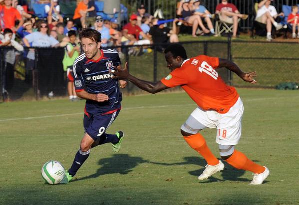 Fire midfielder Dilly Duka drives down field as he is defended by Eagles midfielder Okai Steven.