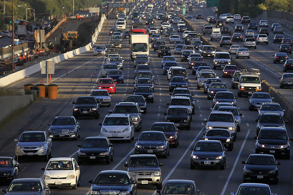 Traffic crawls along the northbound 405 freeway during rush hour in Westwood.