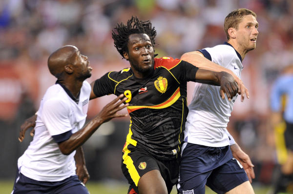 Belgium forward Romelu Lukaku runs for position against DaMarcus Beasley and Clarence Goodson in the first half.