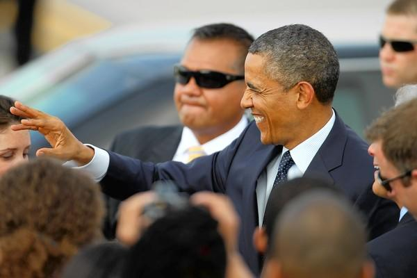 President Barack Obama greets a small crowd shortly after arriving in Chicago on Wednesday to attend Democratic fundraisers.
