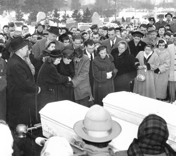 Family members gather at Holy Sepulchre Cemetery for the burial of Chicago teens Barbara and Patricia Grimes in January 1957: Sister Theresa Grimes, from left, mother Loretta Grimes; brother Joseph, 14; father Joseph Grimes; and sister Shirley Wojcik. Another brother, James Grimes, is behind his father.
