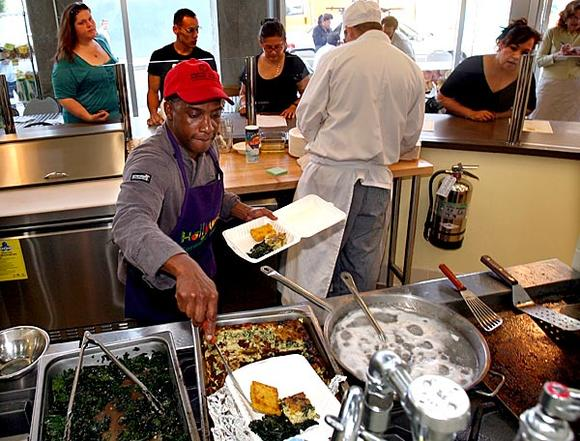 Chef Gil Boyd works at the Farmer's Kitchen, a restaurant at the Hollywood farmers market.