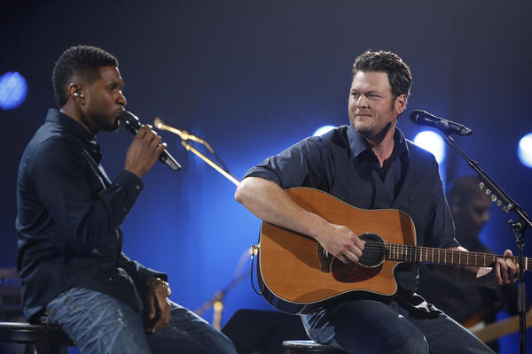 In this handout photo provided by NBC, Usher (L) and Blake Shelton perform during the Healing in the Heartland: Relief Benefit Concert held at the Chesapeake Arena on May 29, 2013 in Oklahoma City, Oklahoma.