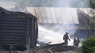 A column of smoke rose into the sky as firefighters raced to the scene of the train derailment. The earth heaved as an explosion rattled residents and pushed windowpanes from their frames. At least one tank car was on fire — no one was sure what else.