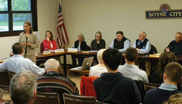 Jennifer Rigterink (left, standing), presented information about the Michigan Economic Development Corporation's Redevelopment Ready Communities program to Boyne City elected officials, staff and residents Tuesday.