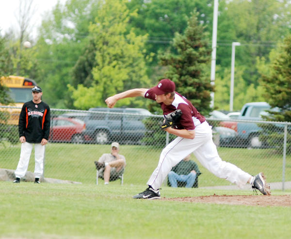 Charlevoixs Tommy Zipp pitches during Wednesdays Division III pre-district contest at Charlevoix High School. Zipp struck out seven over seven innings as the Rayders defeated the Elks, 7-5. Charlevoix will face Harbor Springs in a district semifinal at 10 a.m. Saturday, June 1, in Charlevoix.