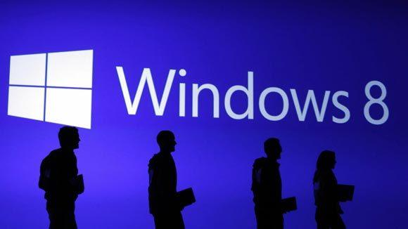 Guests are silhouetted at the launch event of Windows 8 operating system in New York in October.