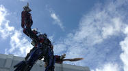 A new icon has sprung onto the Orlando theme park scene. A gigantic version of Optimus Prime now stands above the entrance of Universal Studios' upcoming attraction Transformers: The Ride -- 3D.