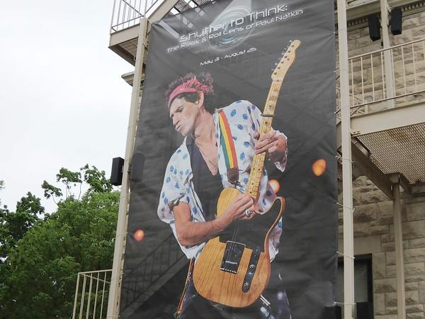 A banner showing Rolling Stones guitarist Keith Richards advertises a rock 'n' roll exhibit at the Elmhurst Historical Museum.