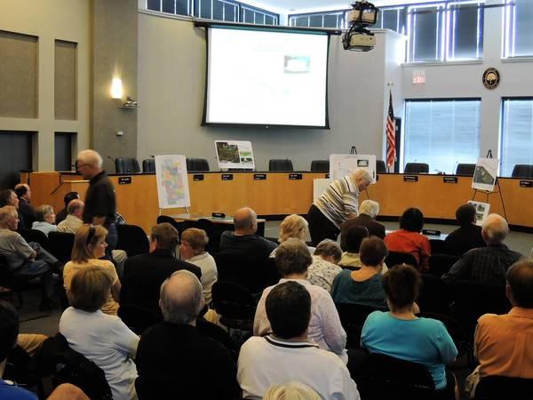 Elmhurst residents review proposed flood mitigation plans.