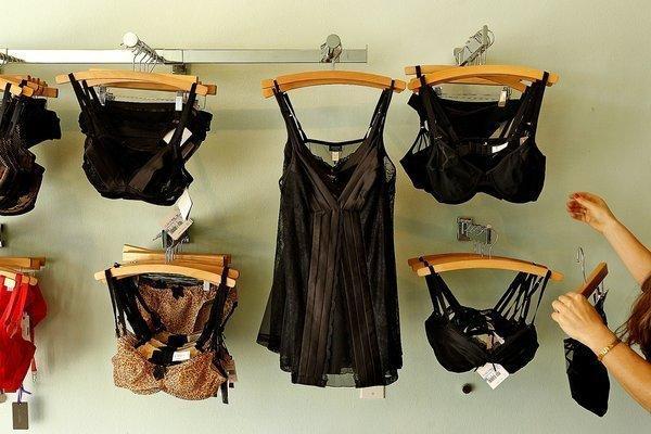 Owner Jen Abercrombie straightens up racks at her lingerie shop, Panty Raid, in Los Feliz, California.