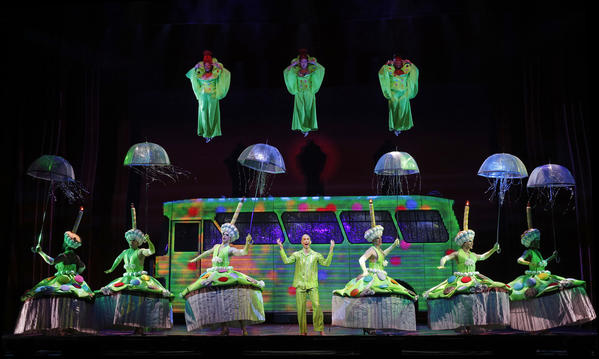 "Tick (Wade McCollum) performs ""MacArthur Park"" as a cake-drunk fantasia with dangling divas and the ensemble of ""Priscilla Queen of the Desert: The Musical,"" now at the Pantages Theatre."