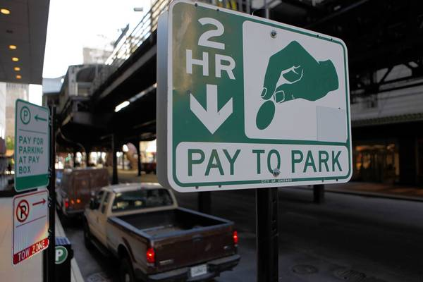 A parking payment kiosk sign on Wabash Avenue near Adams Street downtown.