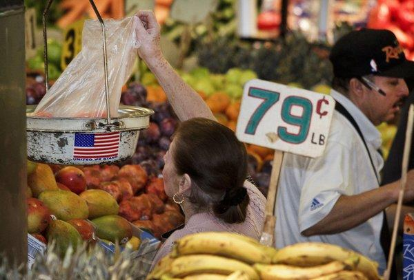 A shopper uses a plastic bag at Grand Central Market in Los Angeles.