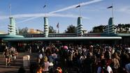 Guests wait in line to enter Walt Disney Co.'s California Adventure Park, part of the Disneyland Resort, in Anaheim, California, U.S., on Friday, May 24, 2013. (Patrick T. Fallon/Bloomberg)
