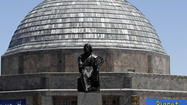 The Adler Planetarium laid off nearly 8 percent of its staff Thursday when it cut 15 positions.  A spokeswoman declined to say whether the laid off staffers were scientists, managers, or other workers.