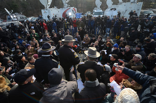 State Police Lt. Paul Vance addresses a horde of news people a day after the massacre at Sandy Hook Elementary School in Newtown.