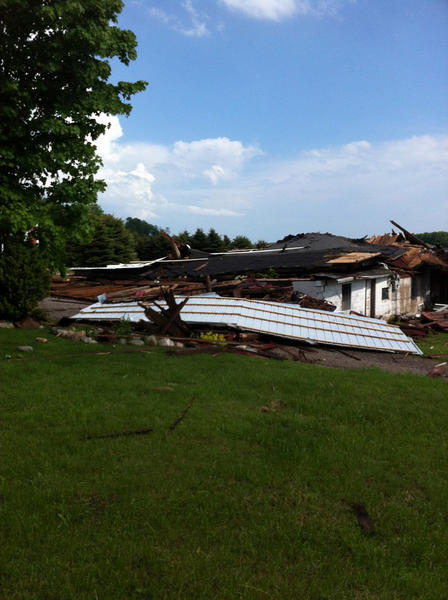 A historic barn on Blackbird Road in Resort Township was brought down during the isolated thunderstorm that hit Emmet and Charlevoix counties late Thursday afternoon.