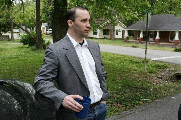 Everett Dutschke stands in the steet near his home in Tupelo, Miss., in April and waits for the FBI to arrive and search his home in connection with the sending of poisoned letters to President Obama and others.