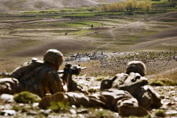 U.S. soldiers take part in an overwatch operation in Afghanistan's Wardak province by keeping an eye on Afghan forces on patrol and preparing them to take over security.